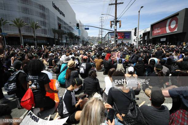 protesters sit and block a street during demonstrations following the death of George Floyd on May 30 2020 in Los Angeles California Former...