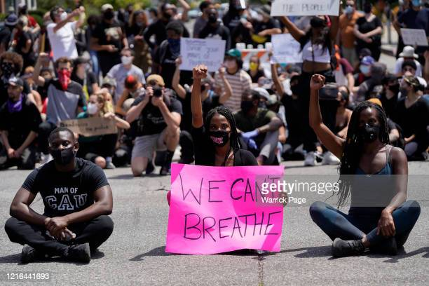 protesters sit at an intersection in West Hollywood during demonstrations following the recent death of George Floyd on May 30 2020 in Los Angeles...