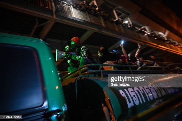 Protesters sit atop a water truck at the Ratchaprasong Intersection on November 18, 2020 in Bangkok, Thailand. Pro-democracy protesters amassed at a...
