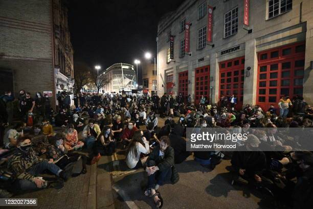 Protesters sit in the street outside Bridewell police station during a Kill the Bill protest on March 30, 2021 in Bristol, England. Last Friday 10...