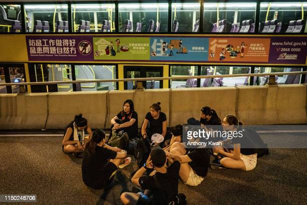 Protesters sit on a highway as they demonstrate against the nowsuspended extradition bill on June 16 2019 in Hong Kong China Large numbers of...
