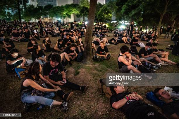 Protesters sit on at Tamar Park after a rally against the nowsuspended extradition bill on June 16 2019 in Hong Kong China Large numbers of...