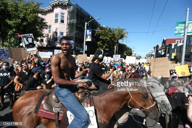 Protesters sit on horses during a demonstration to honor of George Floyd on June 03 2020 in San Francisco California Thousands of of people came out...