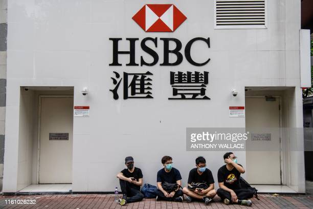 Protesters sit outside a HSBC in the Kowloon district of Hong Kong on August 11 in the latest opposition to a planned extradition law that was...