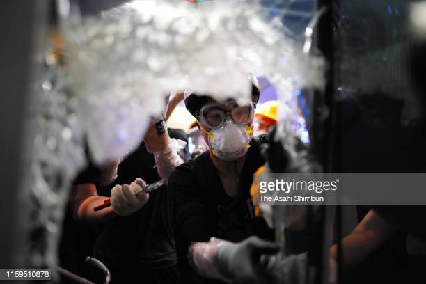 Protesters smash glass windows of the Legislative Council building on July 1 2019 in Hong Kong Thousands of prodemocracy protesters faced off with...
