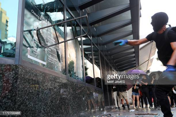 TOPSHOT Protesters smash the Cheung Sha Wan government office window during a demonstration in Hong Kong on October 1 as the city observes the...