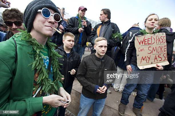 "Protesters smoke marijuana as they take part in a demonstration against new government legislation calling for the creation of a ""weed pass"" and the..."