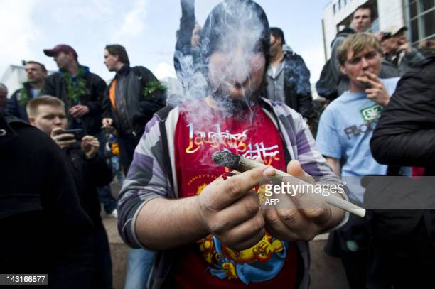 Protesters smoke marijuana during a demonstration against new government legislation calling for the creation of a 'weed pass' and the stopping of...