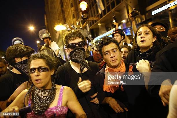 Protesters some affiliated with the Occupy Wall Street movement briefly clash with police as they demonstrate in downtown Chicago on the eve of the...