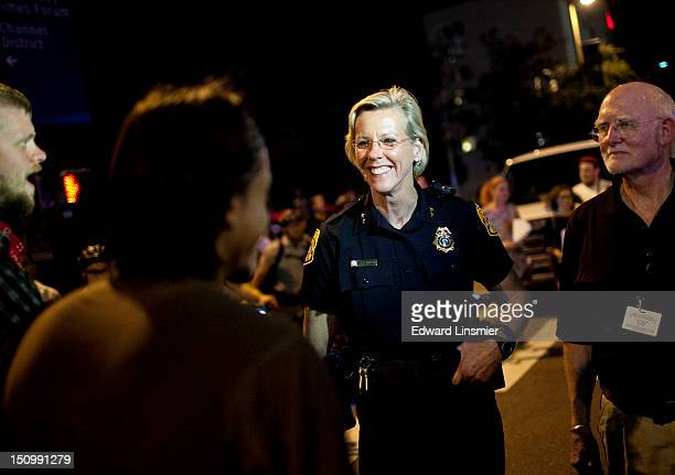 Protesters speak with Tampa Police Chief Jane Castor while marching during the Republican National Convention on August 29 2012 in Tampa Florida The...