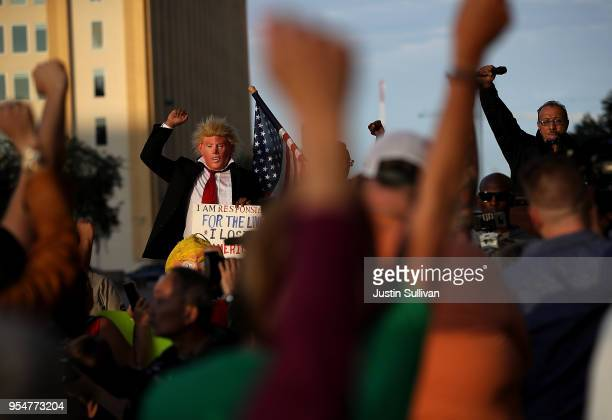 Protesters stage a demonostration outside of Dallas City Hall before marching to the NRA Annual Meeting Exhibits at the Kay Bailey Hutchison...