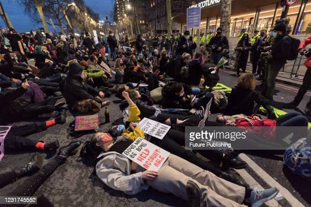 Protesters stage a die in outside the New Scotland Yard during a protest against governments proposed Police, Crime and Sentencing Bill, which would...