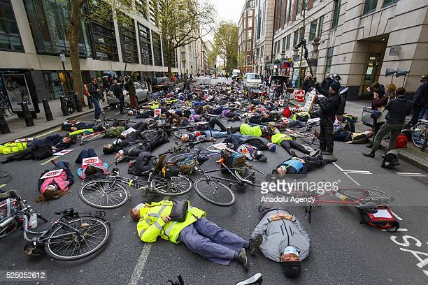 Protesters stage a diein protest with gas masks and teddy bears at an antipollution rally outside the Department for Transport in London England to...