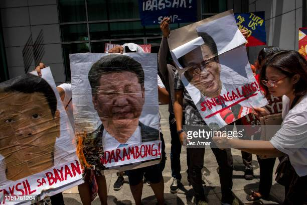 Protesters stage a lightning rally condemning Xi Jin Ping Philippines president Rodrigo Duterte and local government officials on June 25 2019 in...