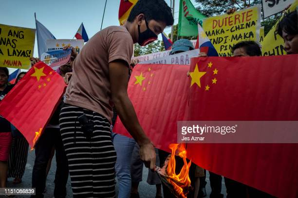 Protesters stage a noise barage on a street condemning China's incursion at the West Philippine Sea on June 19 2019 in Manila Philippines Philippine...