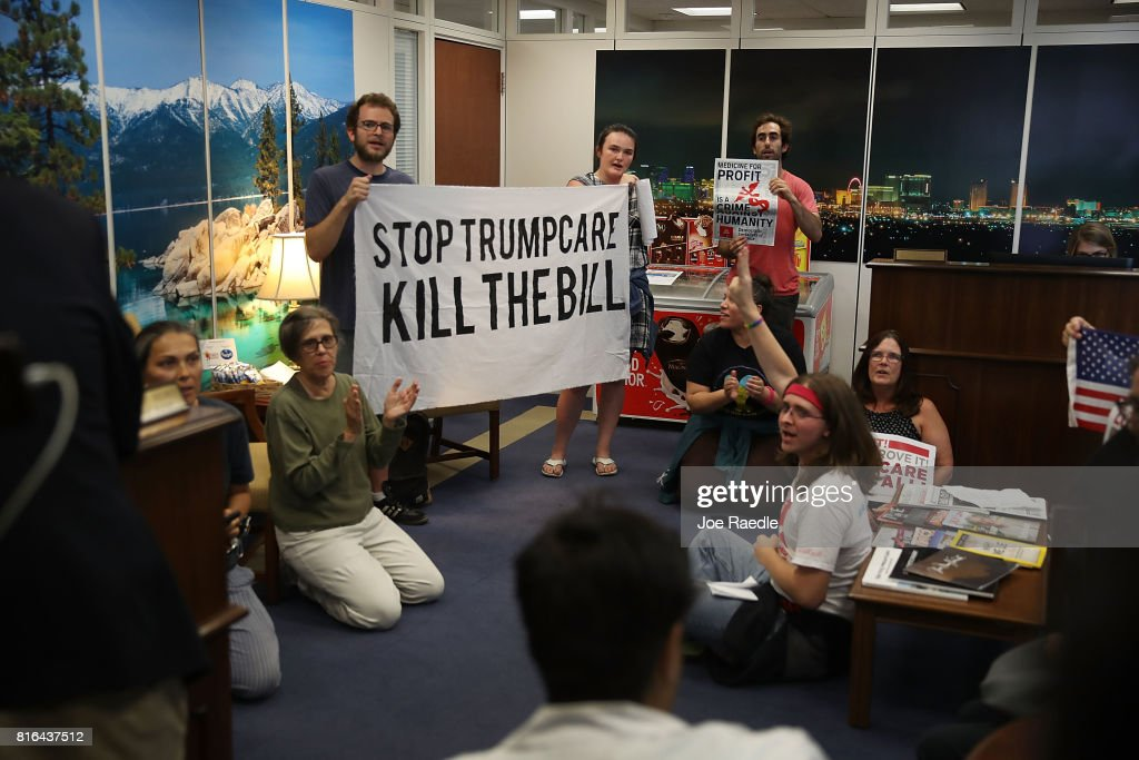 Protesters stage a sit-in at the office of Sen. Dean Heller (R-NV) in the Hart Senate Office Building on July 17, 2017 in Washington, DC. The protesters were asking the Senator to vote no on the Better Care Reconciliation Act.