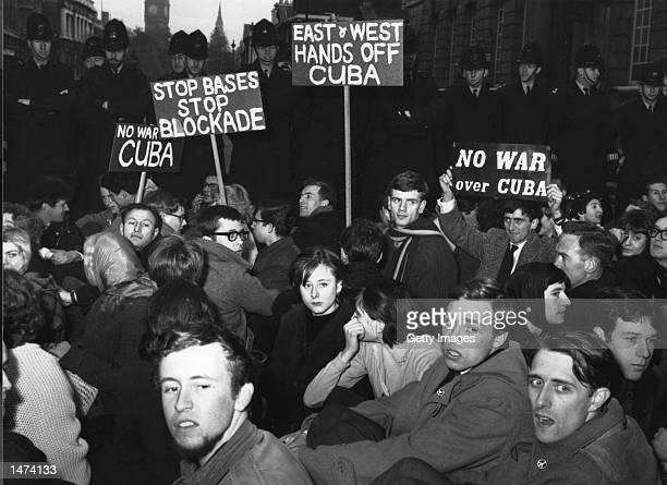 Protesters stage a sitin during a demonstration against the Cuban missile crisis October 24 1962 in London United Kingdom Former Russian and US...