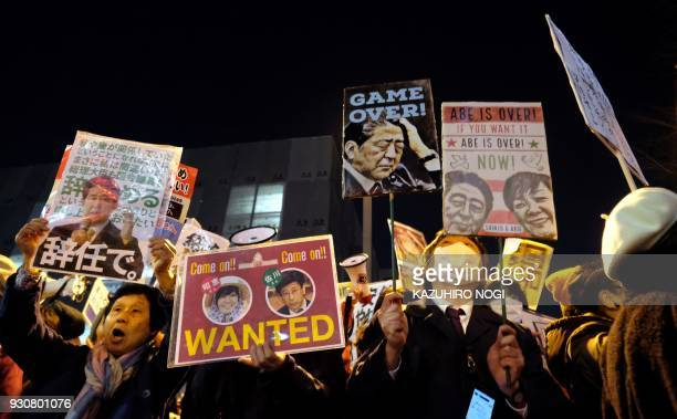 TOPSHOT Protesters stage an antiAbe demonstration near the prime minister's official residence in Tokyo on March 12 2018 Japan's finance ministry...