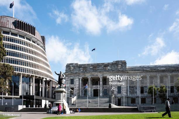 Protesters stand by a statue of Richard John Seddon, a former prime minister of New Zealand, at the New Zealand Parliament Buildings in Wellington,...