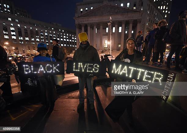 Protesters stand in Foley Square in New York City on December 4 2014 during demonstration against the chokehold death of an unarmed black fatherofsix...