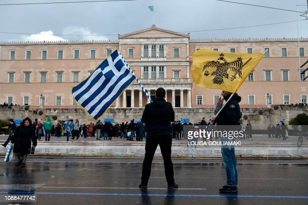 Protesters stand in front of the Greek Parliament in Athens on January 25, 2019. - Greek lawmakers on January 25 ratified a landmark name change deal...