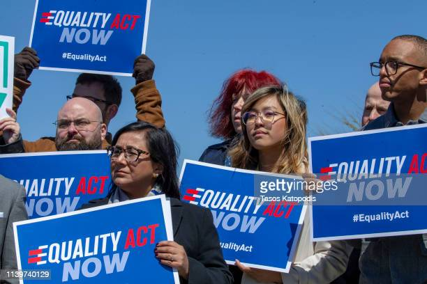 Protesters stand in support of a introduction of the Equality Act a comprehensive LGBTQ nondiscrimination bill at the US Capitol on April 01 2019 in...