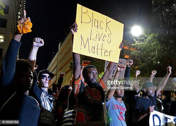 Protesters stand in unity in Romare Bearden Park as they prepare to march throughout the city of Charlotte NC on Friday Sept 23 as demonstrations...