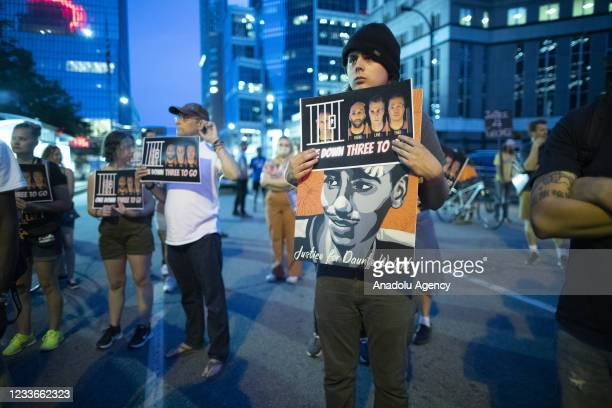 Protesters stand near the Hennepin County Government Center to raise awareness to the other 3 officers that are going to trial in the killing of...