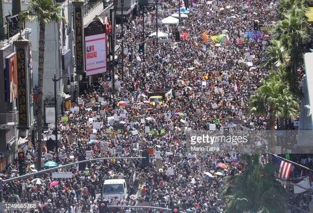 Protesters stand on Hollywood Boulevard during the All Black Lives Matter solidarity march, replacing the annual gay pride celebration, as protests...
