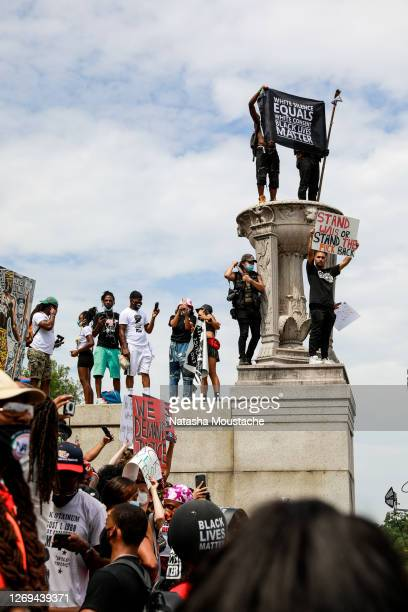 Protesters stand on the Lincoln Memorial during the Commitment March on August 28, 2020 in Washington, DC. Rev. Al Sharpton and the National Action...