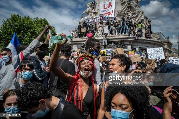 Protesters stand on the monument in Place de la Republique during an antiracism protest on June 13, 2020 in Paris, France. The anti-racism protests...