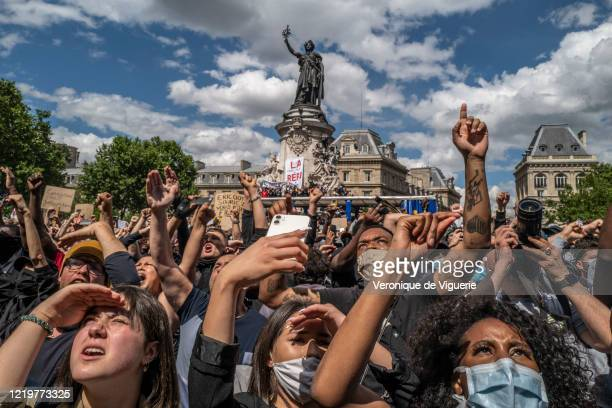 Protesters stand on the monument in Place de la Republique during an antiracism protest on June 13 2020 in Paris France The antiracism protests here...