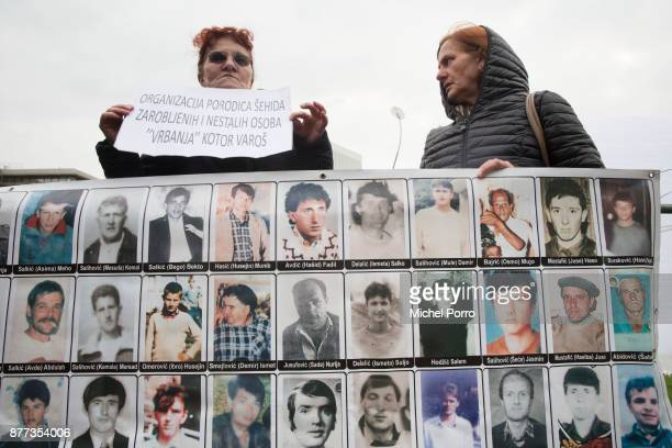 Protesters stand outside the court before former Bosnian military chief Ratko Mladic appears for the pronouncement of the Trial Judgement for the...