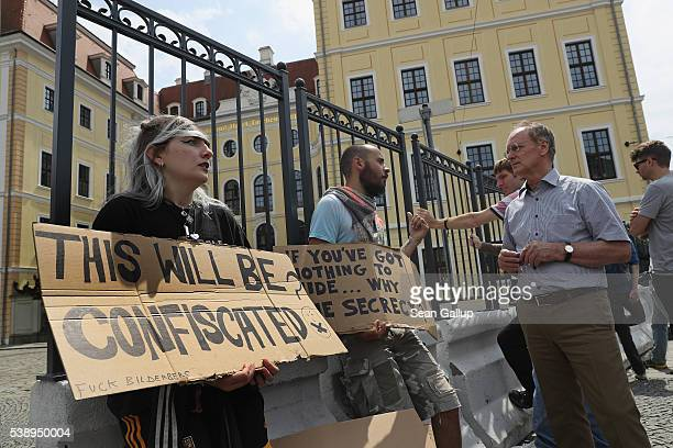 Protesters stand outside the Hotel Taschenbergpalais Kempinski Dresden venue of the 2016 Bilderberg Group conference on June 9 2016 in Dresden...