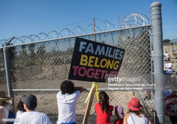 Protesters stand outside the James A. Musick Facility, a detention center that houses unauthorized immigrants, to protest President Trump's...
