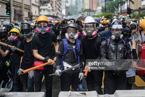 Protesters standoff with police during a clash at an antigovernment rally in Tsuen Wan district on August 25 2019 in Hong Kong China Prodemocracy...