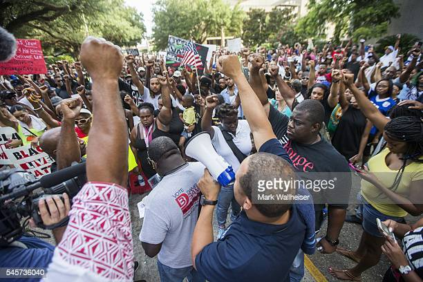 Protesters start the march from Baton Rouge City Hall to the Louisiana Capitol with a prayer in protest of the shooting of Alton Sterling on July 9...