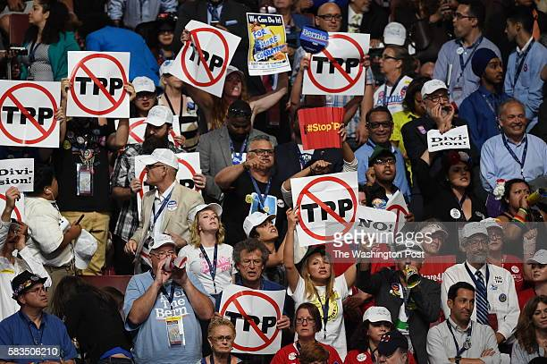 Protesters state their position on the TransPacific Partnership during the first day of the Democratic National Convention in Philadelphia on Monday...
