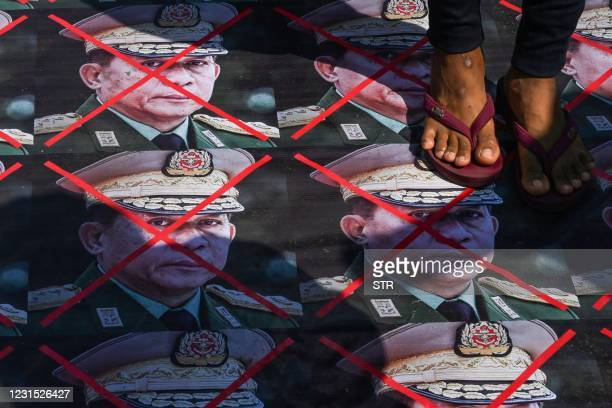 Protesters step on portaits of Myanmar's armed forces chief Senior General Min Aung Hlaing placed on a street during a demonstration against the...
