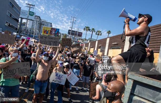 Protesters stop at Santa Monica Blvd. And La Cienega Blvd. During march through West Hollywood to demand justice for the killing of George Floyd...