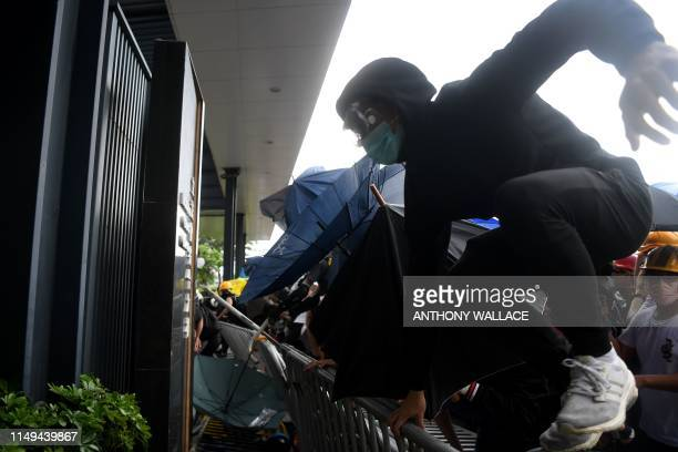 Protesters storm the Legislative Council building during a rally against a controversial extradition law proposal in Hong Kong on June 12 2019...