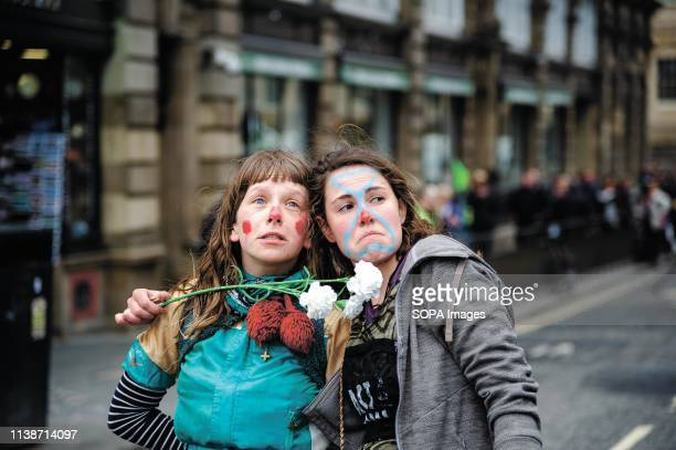 Protesters strike a pose for the camera during the demonstration Extinction Rebellion held a lockdown of Edinburgh's North Bridge as part of an...