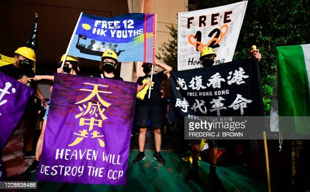 Protesters supporting Hong Kong gather across the road from the Chinese Consulate in Los Angeles on October 1, 2020 during a global day of action...