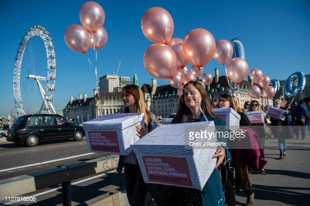 Protesters supporting Northern Ireland's abortion laws at Parliament Square on February 26 2019 in London England The protesters each held a box...