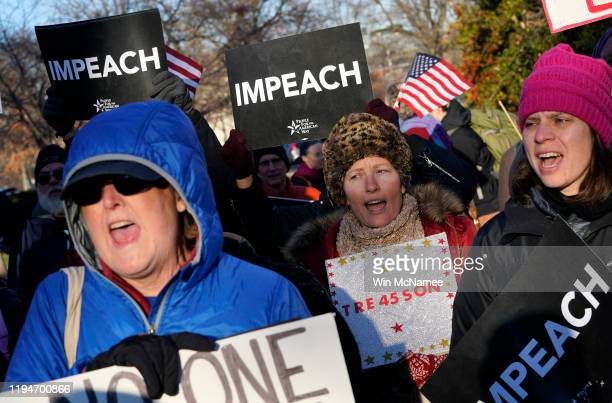 Protesters supporting the impeachment of US President Donald Trump gather outside the US Capitol December 18 2019 in Washington DC Later today the US...