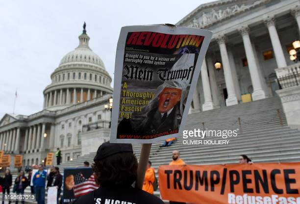 Protesters supporting the impeachment of US President Donald Trump gather outside the US Capitol ahead of his State of the Union address on February...
