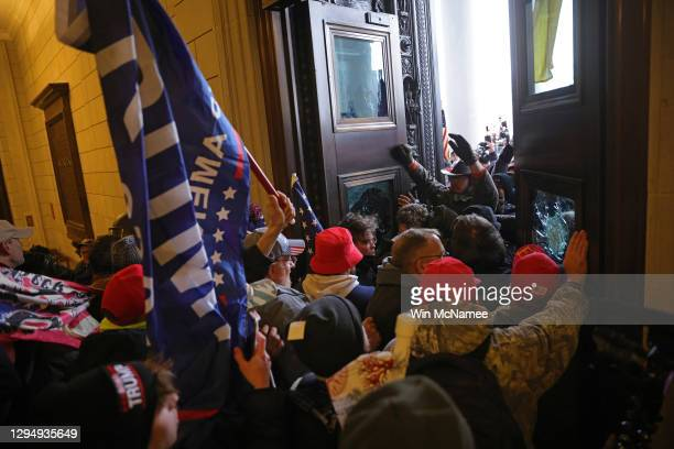 Protesters supporting U.S. President Donald Trump break into the U.S. Capitol on January 06, 2021 in Washington, DC. Congress held a joint session...