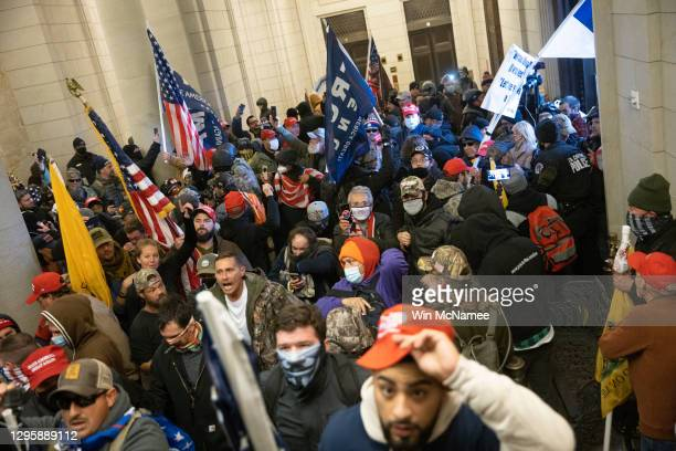 Protesters supporting U.S. President Donald Trump gather near the east front door of the U.S. Capitol after groups breached the building's security...
