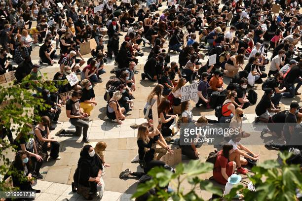 Protesters 'take a knee' at a gathering in support of the Black Lives Matter and Black Voices Matter movements in central Leeds in northern England...