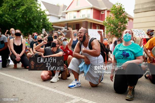 Protesters take a knee outside the Monroe County Justice Building during the demonstration. Protesters are demanding justice for Vauhxx Booker, who...